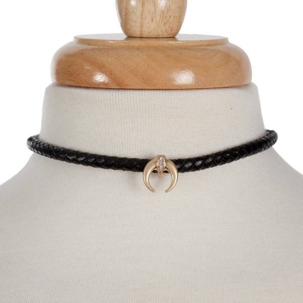 """Black braided leather cord choker necklace with a crescent pendant. Approximately 13"""" in length"""