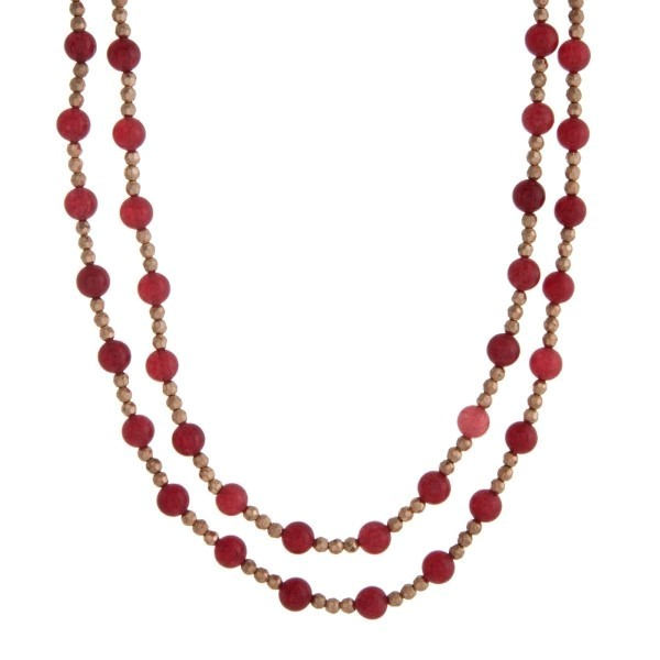 """Gold tone beaded wrap necklace with burgundy natural stone beads. Approximately 60"""" in length."""