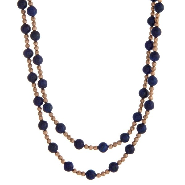 "Gold tone beaded wrap necklace with blue natural stone beads. Approximately 60"" in length."