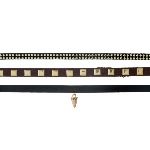 """Triple row brown suede choker with gold tone studs and dainty horn pendant. Approximately 13"""" in length."""