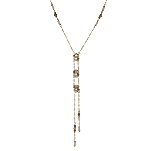 """Gold tone dainty 'Y' necklace with bronze and ivory beads. Approximately 26"""" in length."""
