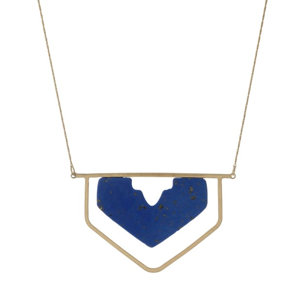 "Gold tone necklace with a blue stone and geometric pendant. Approximately 32"" in length."