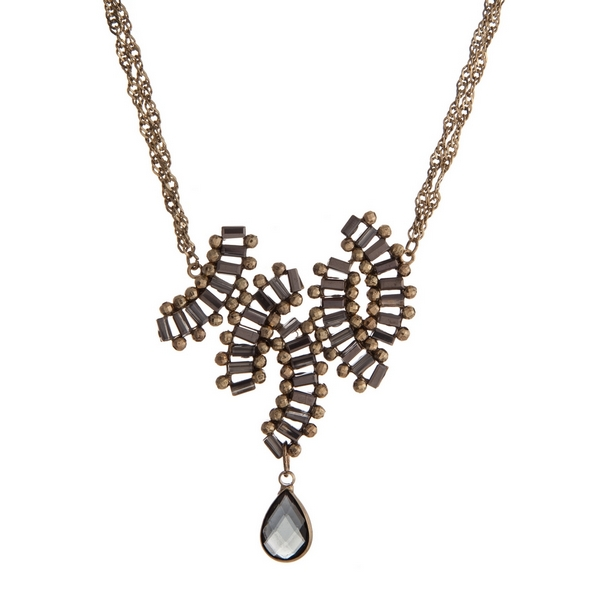 """Burnished gold tone necklace with hematite beads and a gray teardrop stone. Approximately 16"""" in length."""
