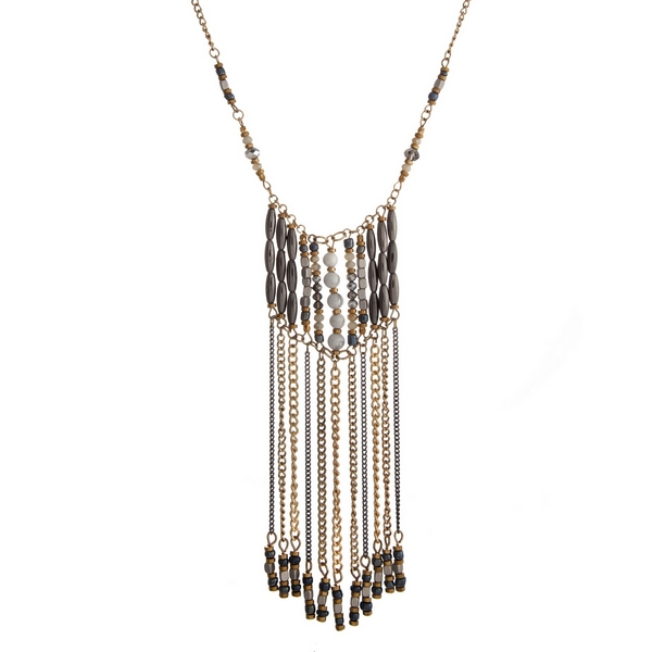 """Gold tone necklace with a white and gray beaded pendant accented with metal fringe. Approximately 32"""" in length."""