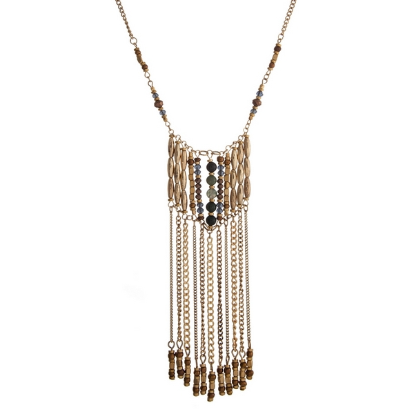 """Gold tone necklace with a green and brown beaded pendant accented with metal fringe. Approximately 32"""" in length."""