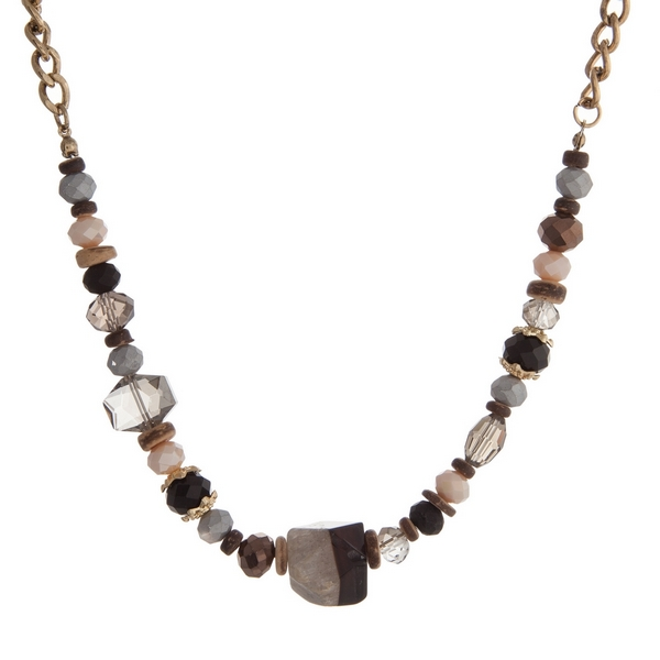 """Gold tone necklace with gray, ivory and black faceted and natural stones. Approximately 16"""" in length."""