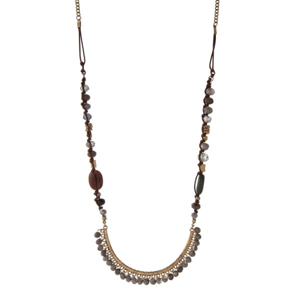 """Gold tone and brown cord necklace with a gray, brown, and green beaded half circle pendant. Approximately 32"""" in length."""