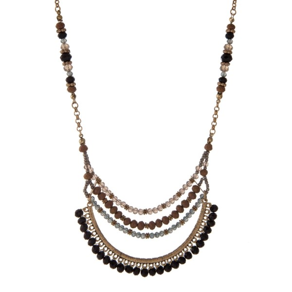 """Gold tone necklace with a black, gray, and bronze beaded half circle pendant. Approximately 16"""" in length."""