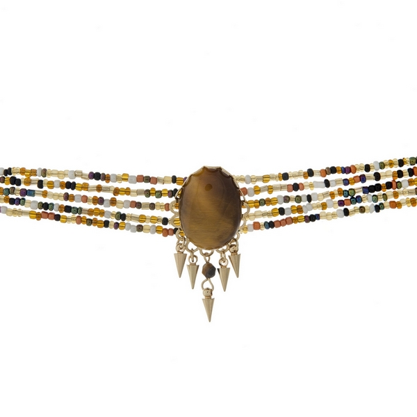 """Multi row beaded choker with a brown faceted stone focal and gold tone accents. Approximately 12"""" in length."""