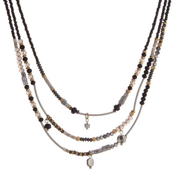 Triple row beaded necklace with black and gray faceted beads.