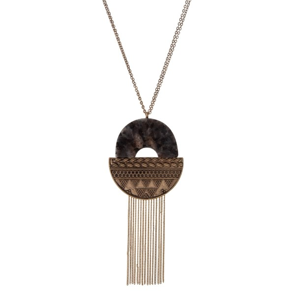 """Burnished gold tone necklace with a tribal pendant, accented with labradorite natural stone and metal fringe. Approximately 32"""" in length."""