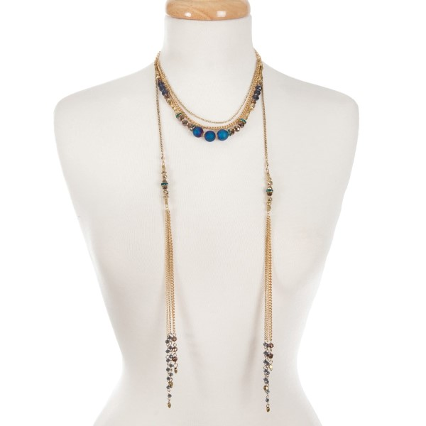 "Gold tone multi layer necklace with bronze and blue beads. Approximately 16"" in length."