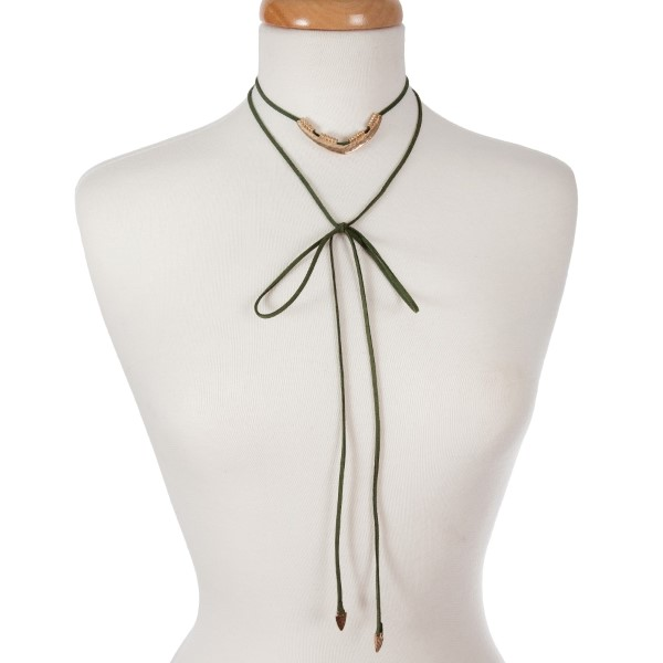 Olive green suede wrap necklace with an adjustable short layer displaying a hammered silver tone triangle and arrowheads on the long ends. Can be adjusted to any length up to 36 inches.