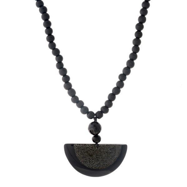 """Black wooden beaded necklace with an acrylic half circle pendant. Approximately 32"""" in length."""