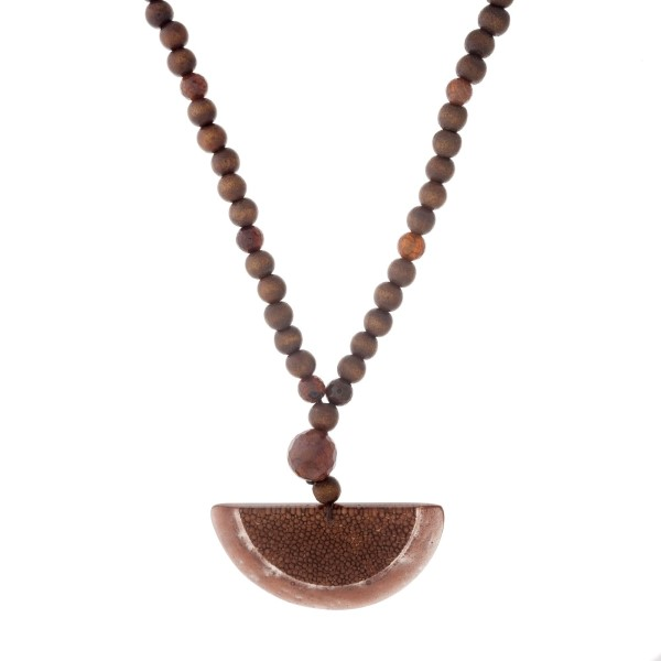 """Brown wooden beaded necklace with an acrylic half circle pendant. Approximately 32"""" in length."""