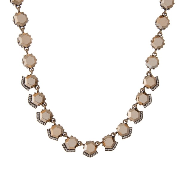 """Gold tone necklace with bronze hexagonal stones. Approximately 16"""" in length."""