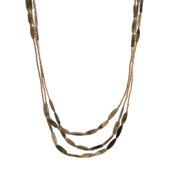 """Beaded triple row necklace with olive green natural stone rectangle beads. Approximately 32"""" in length."""