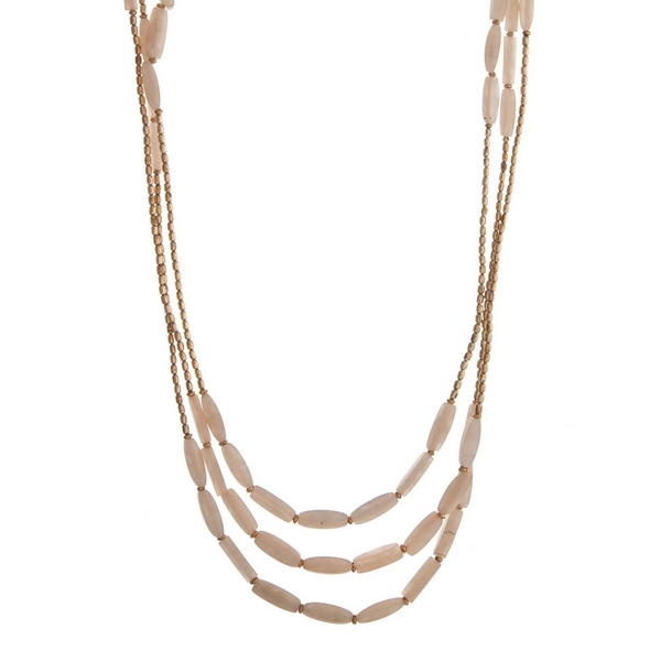 "Beaded triple row necklace with ivory natural stone rectangle beads. Approximately 32"" in length."