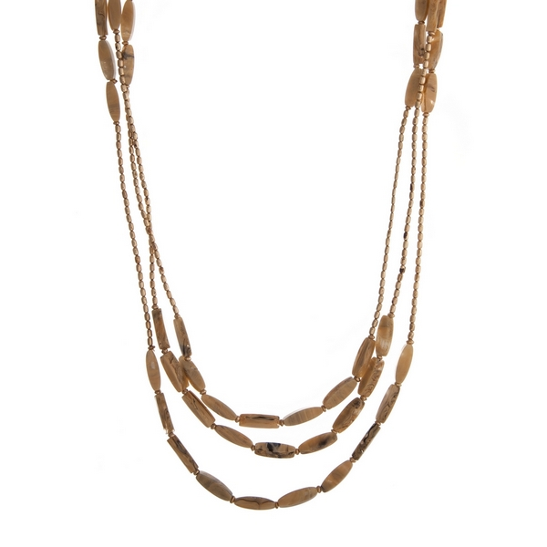 """Beaded triple row necklace with beige natural stone rectangle beads. Approximately 32"""" in length."""