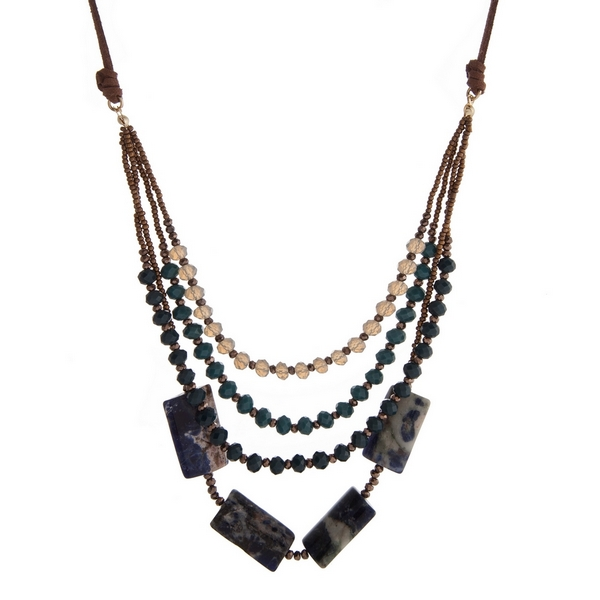 "Brown suede necklace with teal and gray faceted beads and lapis square beads. Adjustable up to 32"" in length."