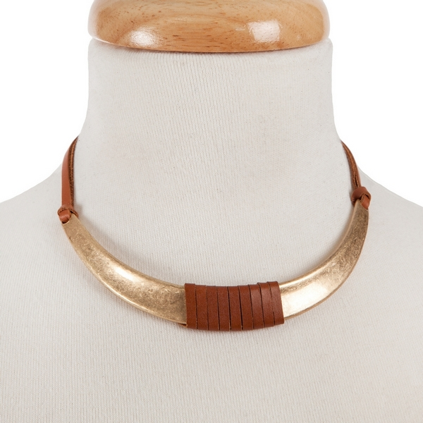 """Tan leather necklace with a burnished gold tone curved bar wrapped in leather. Approximately 14"""" in length."""