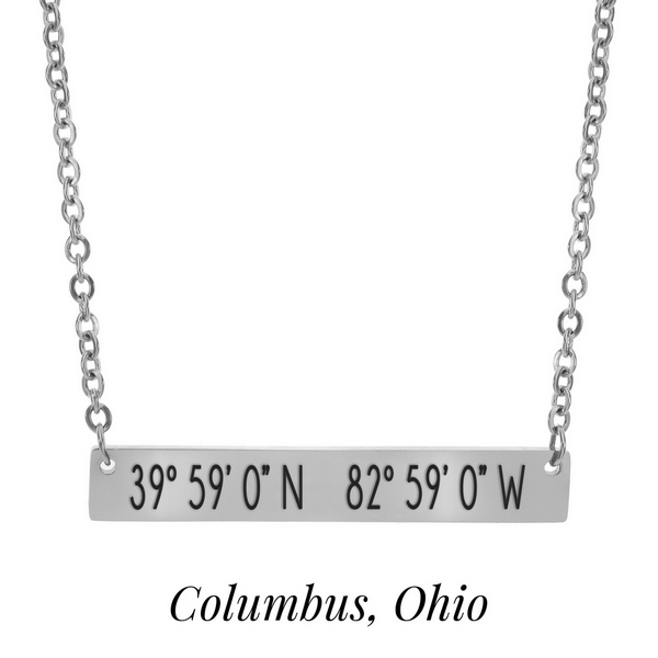 "Silver tone necklace with a bar pendant stamped with the coordinates of Columbus, Ohio. Approximately 18"" in length."