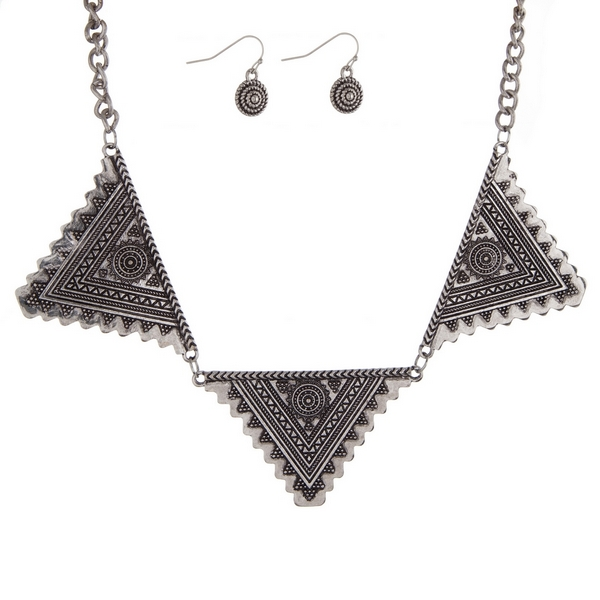 """Burnished silver tone necklace set with hammered metal triangles and matching fishhook earrings. Approximately 17"""" in length."""