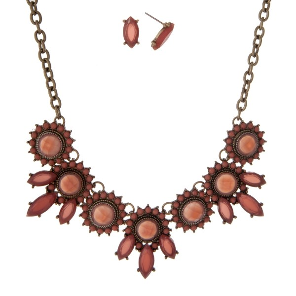 """Burnished gold tone necklace set with mauve circle and oval stones. Approximately 16"""" in length."""