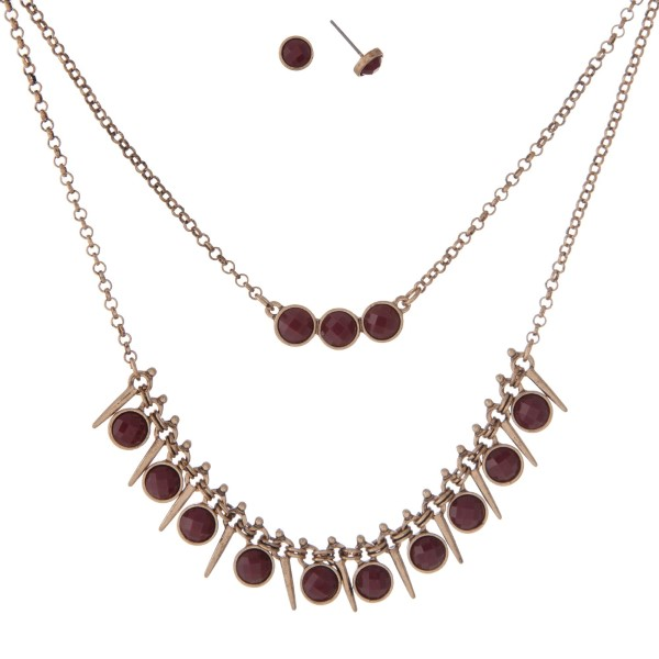 """Burnished gold tone double layer necklace set with burgundy faceted stones. Approximately 16"""" in length."""