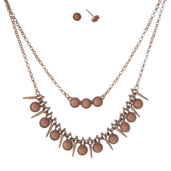 """Burnished gold tone double layer necklace set with beige faceted stones. Approximately 16"""" in length."""