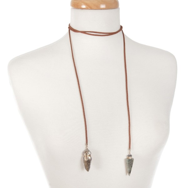 "Brown faux suede wrap necklace with hammered gold tone arrowhead and gray labradorite arrowhead pendant. Approximately 55"" in length."