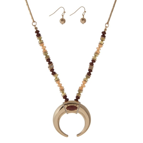 """Gold tone necklace set with brown and olive green beads and a crescent pendant. Approximately 18"""" in length."""