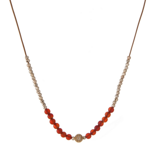"""Brown cord necklace with gold tone and carnelian, natural stone beads. Approximately 16"""" in length. Handmade in the USA."""