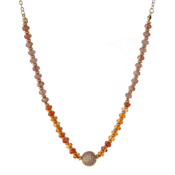 """Gold tone necklace with topaz and carnelian faceted, glass beads and a pave rhinestone focal. Approximately 16"""" in length. Handmade in the USA."""