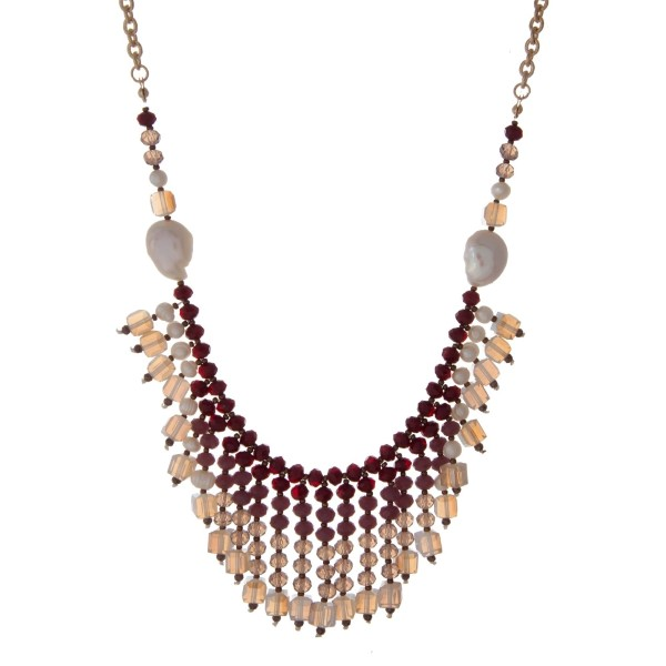 """Gold tone necklace with freshwater pearls, burgundy, purple, and white opal beads. Approximately 32"""" in length."""