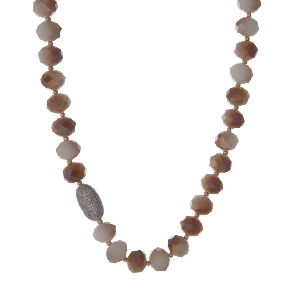 """Ivory and topaz beaded necklace with gold tone beads and a pave bead focal. Approximately 22"""" in length."""