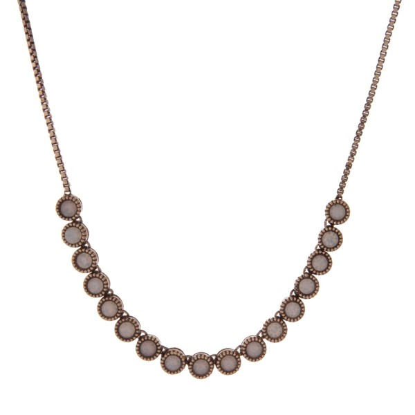 """Adjustable gold tone necklace with white opal stones. Up to 30"""" in length."""