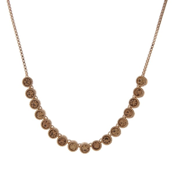 """Adjustable gold tone necklace with topaz stones. Up to 30"""" in length."""