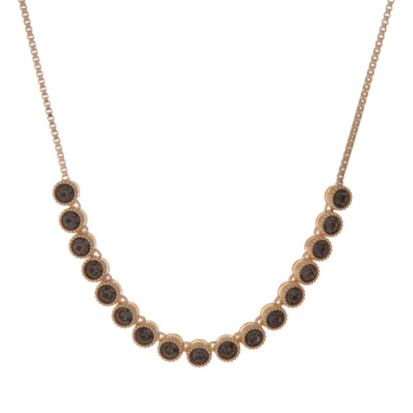 """Adjustable gold tone necklace with gray stones. Up to 30"""" in length."""