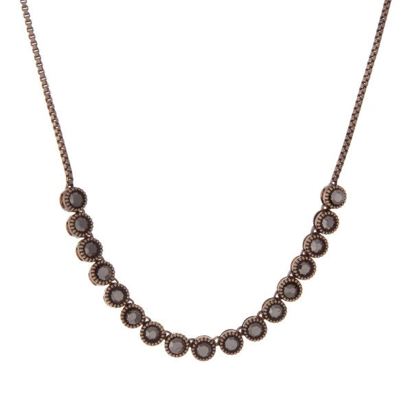 """Adjustable gold tone necklace with black stones. Up to 30"""" in length."""