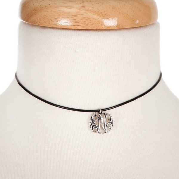 """Black waxed cord choker with a silver tone script 'N' initial. Approximately 12"""" in length."""