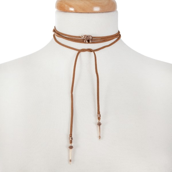"""Brown faux suede wrap necklace with a gold tone elephant focal. Approximately 66"""" in length."""