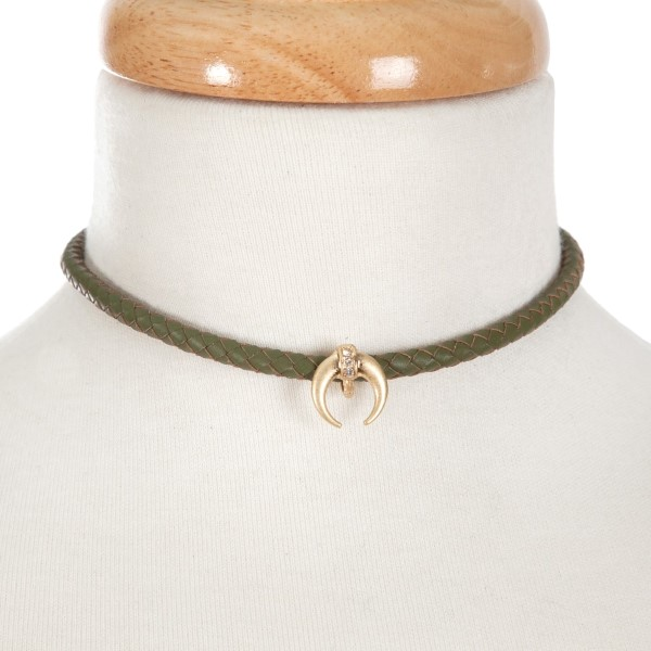 """Olive, braided faux leather choker with a gold tone crescent focal. Approximately 12"""" in length."""