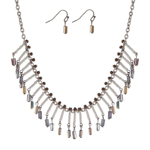 """Silver tone necklace set with iridescent and white beaded fringe. Approximately 16"""" in length."""