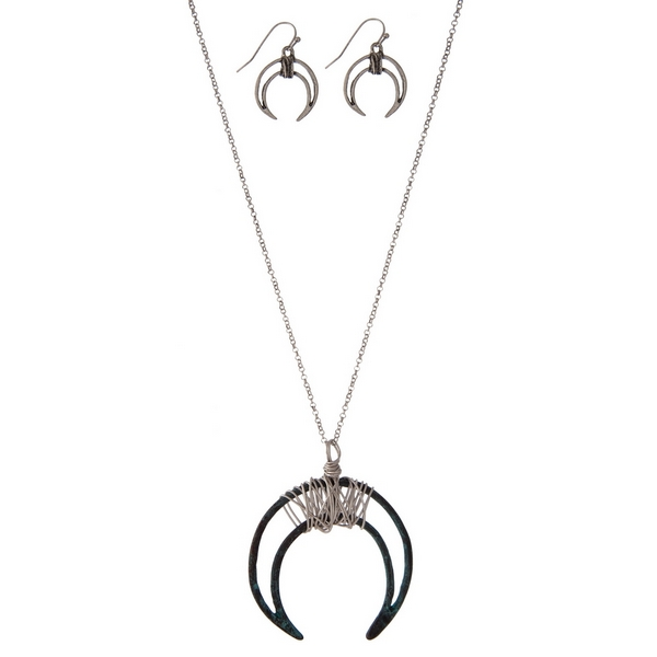 """Silver tone necklace set with a patina crescent pendant and matching fishhook earrings. Approximately 32"""" in length."""