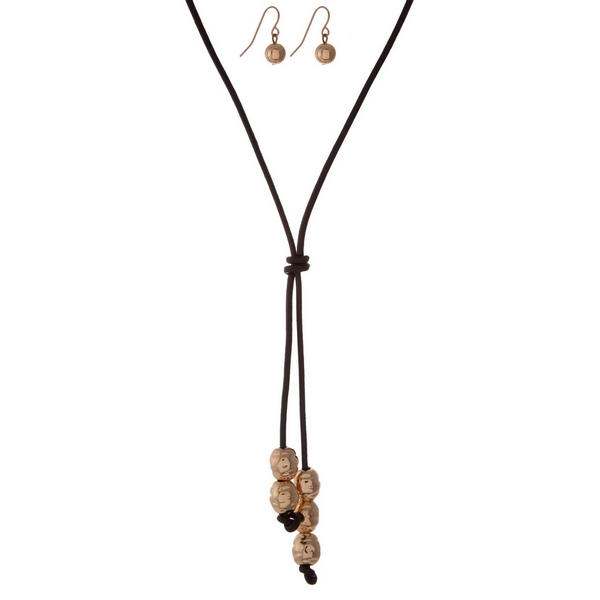 """Brown leather necklace set with a gold tone beaded tassel and matching fishhook earrings. Approximately 20"""" in length."""