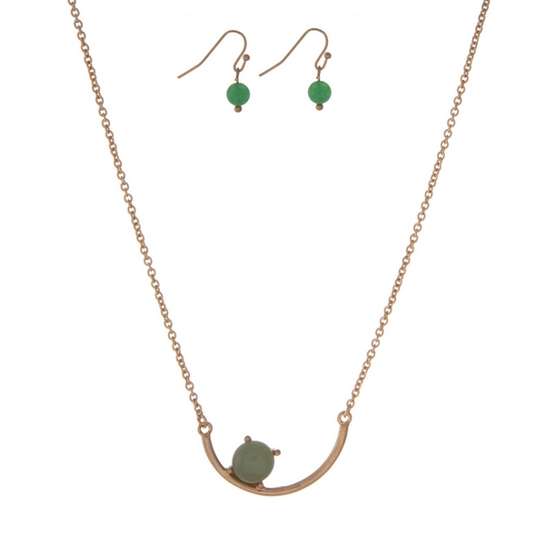 """Dainty gold tone necklace set with a curved bar pendant accented with a green stone. Approximately 16"""" in length."""