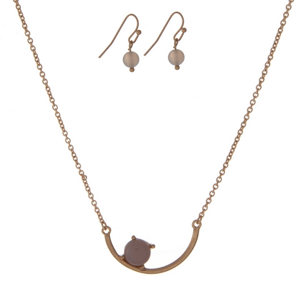 """Dainty gold tone necklace set with a curved bar pendant accented with a gray stone. Approximately 16"""" in length."""