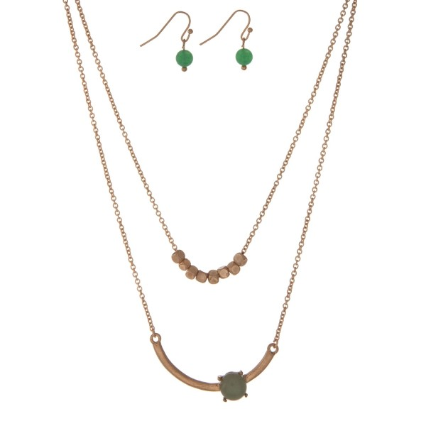 """Dainty gold tone, double layer necklace set with a green stone and gold square beads. Approximately 16"""" in length."""