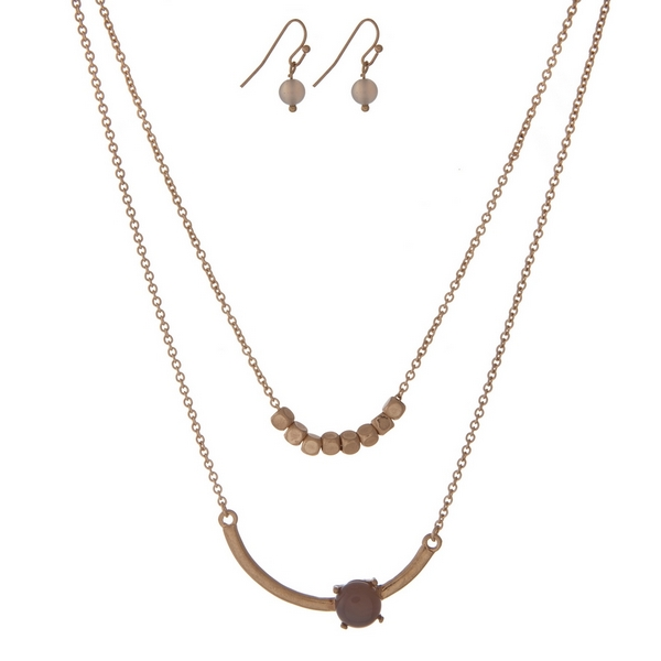 """Dainty gold tone, double layer necklace set with a gray stone and gold square beads. Approximately 16"""" in length."""